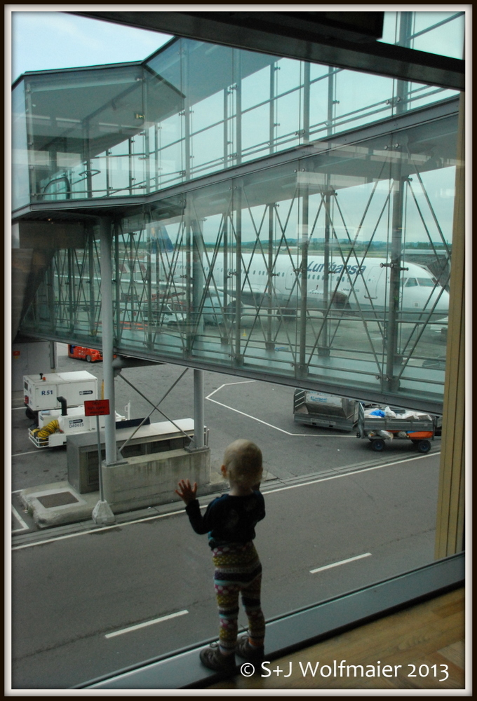 Our daughter enjoying the airport, it has so nice big windows to look out through.