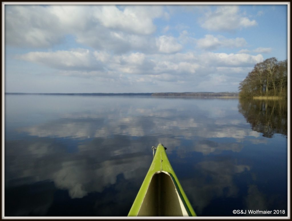 Canoeing on a calm day, the lake is like a painting.